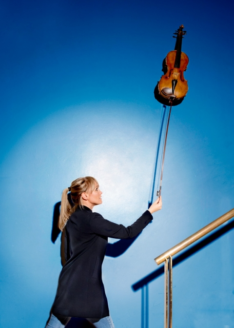 Viola player Gemma Dunne photographed at the Bridgewater Hall. Gemma is viola player with the Halle.