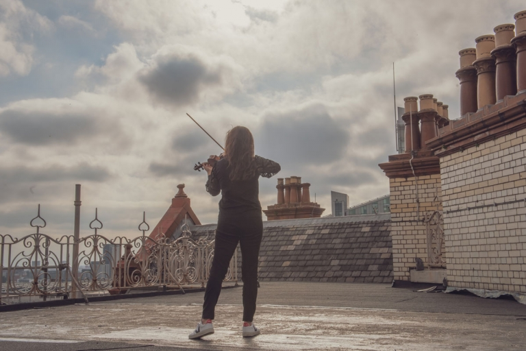 Violinist Rakhi Singh, photographed on the roof of The Midland Hotel, Manchester.